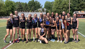 The Middletown North girls track team celebrates its third sectional state championship in the last five championship meets after defeating Mendham by a score of 78-77.