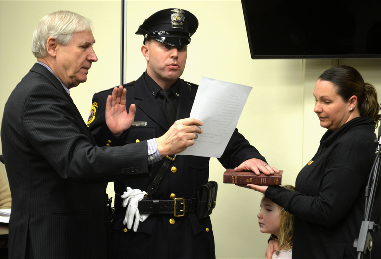 Scotch Plains police officer Brian Regenthal takes the oath of office
