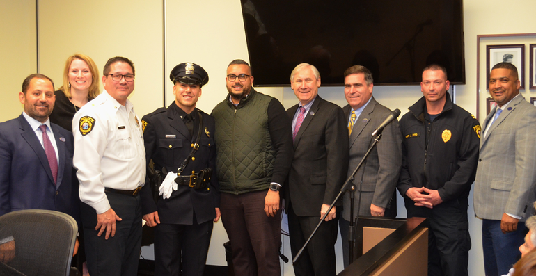 Scotch Plains police officer Javier Maldonado is welcomed by Chief Conley, Capt. Zito, Mayor Smith and the Scotch Plains Council.