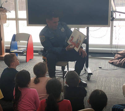Top story 8b049130baadf15309d3 officer cardonna read across american