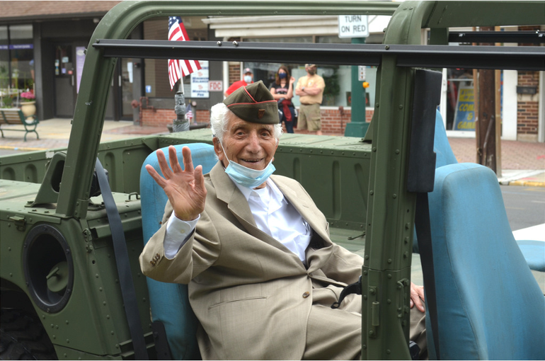 One Hundred and riding in a Humvee. Alphonse Fantini, WWII veteran of Scotch Plains.png
