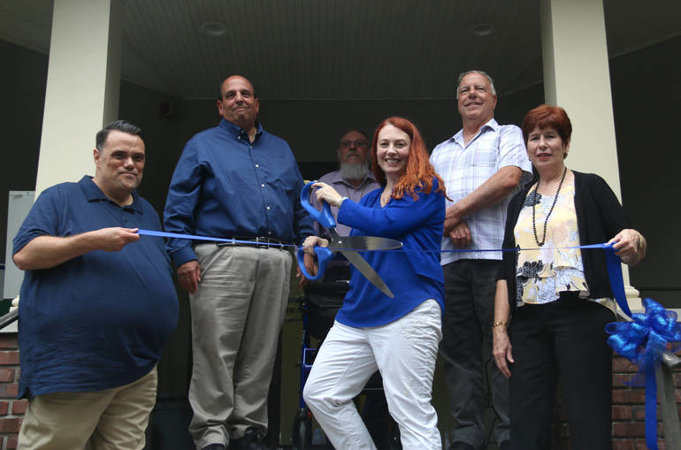 Tamara Robb Cuts Ribbon in Front of New Middlesex Office