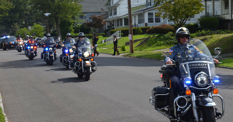 Parenti - Procession approaches church in Plainfield.png