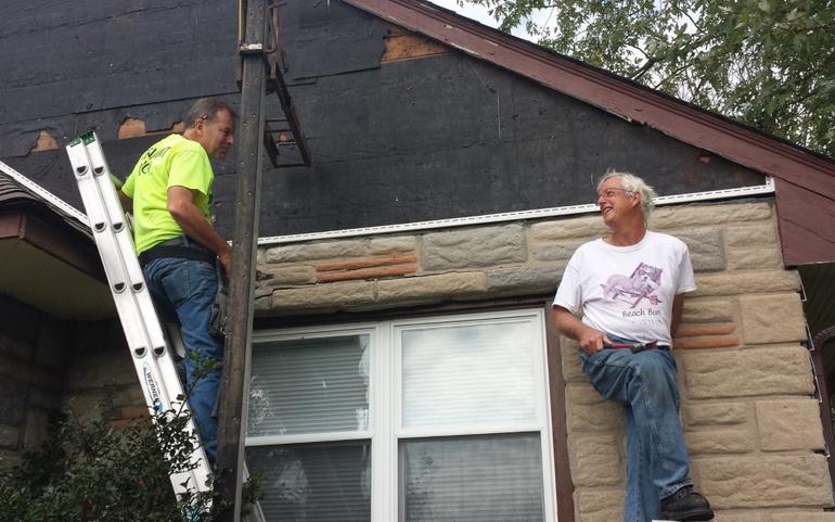 Restoring Siding of the Food Pantry
