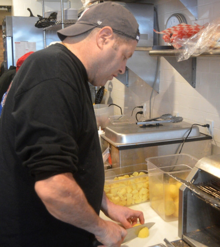 Paul Watterson chops vegetables for his award-winning soups at The Fanwood Grille.