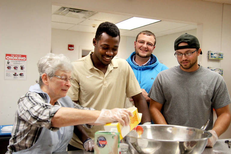 Paul Afful and others in Warming House kitchen print.jpg