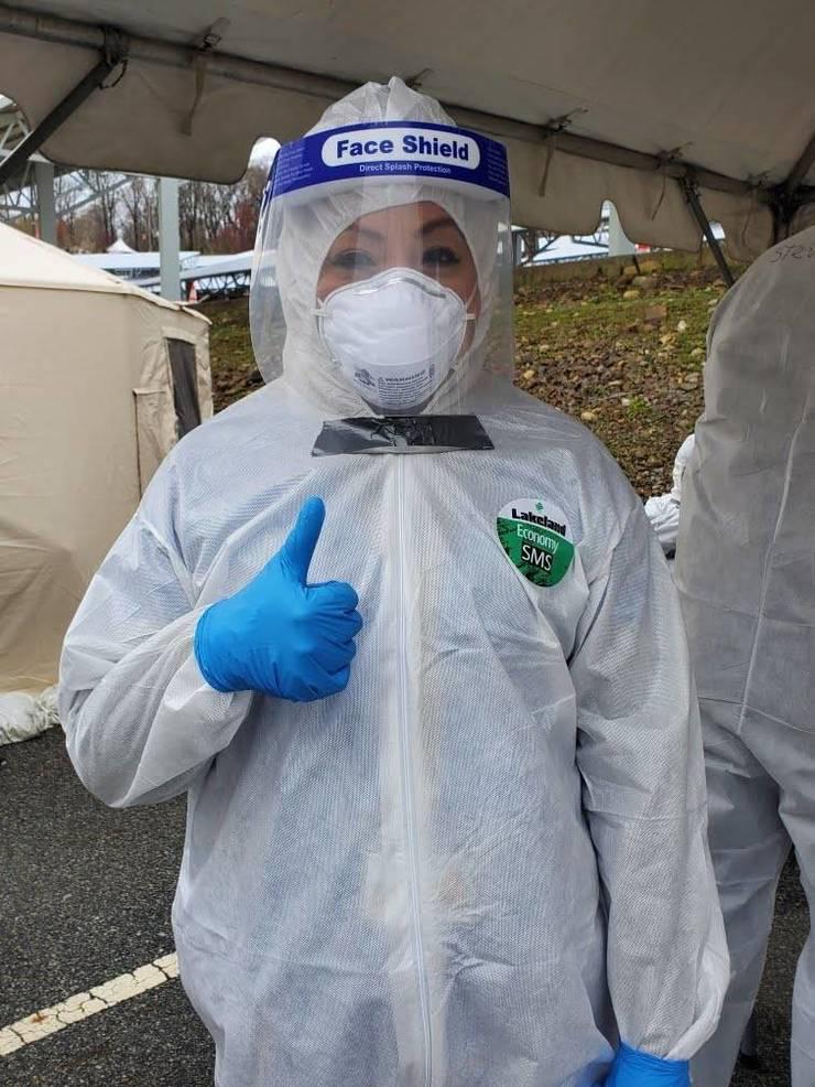 Passaic Co testing site WPU volunteer wearing face shield.jpg