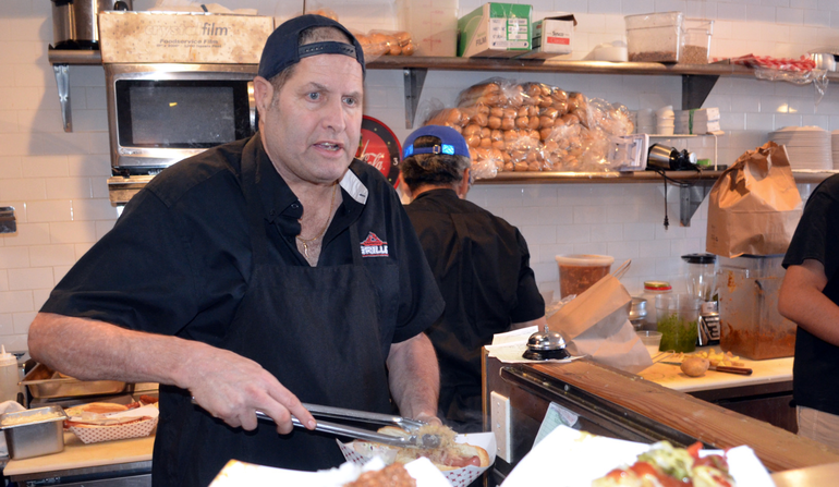 Paul Watterson serves hot dogs at The Fanwood Grille