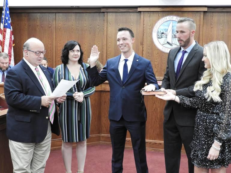 Patrolman Taylor Doremus being sworn in by Mayor Pat Menna.jpg