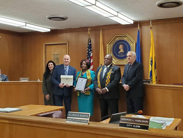 Pastor Elaine Merritt with the Mayor and Council.jpg