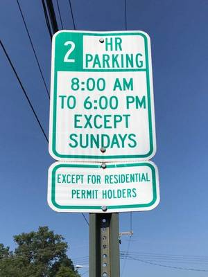 Carousel image 31f362ee2f8432638940 parking hours sign
