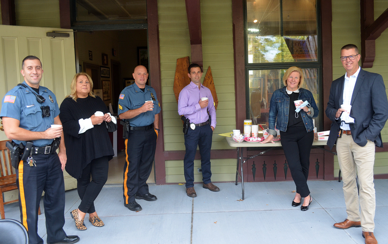 Mayor Colleen Mahr with members of the Fanwood police department.- Coffee with a Cop.png
