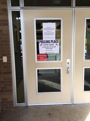 Carousel image 01f73f2b5db8d38f7dc5 polling place door