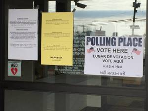 Carousel image 95b51d84861c1077d717 polling place door 2020
