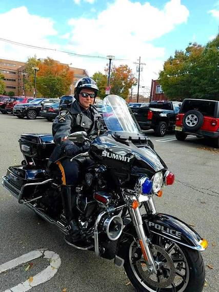 Top story b70c9f6412c94a017469 police motorcycle rider