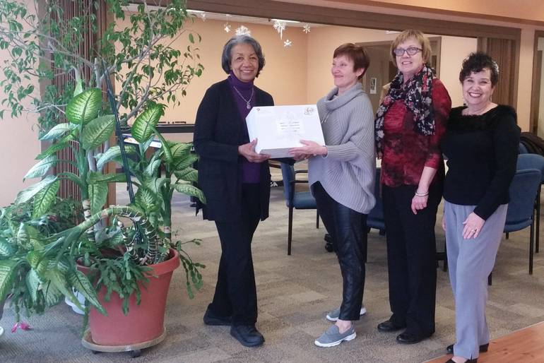 Daryl Miller, Phyllis Beals & Angela Dubivsky Present Cards to Allyson Toth, Manager - Quail Brook Senior Center/Meals on Wheels
