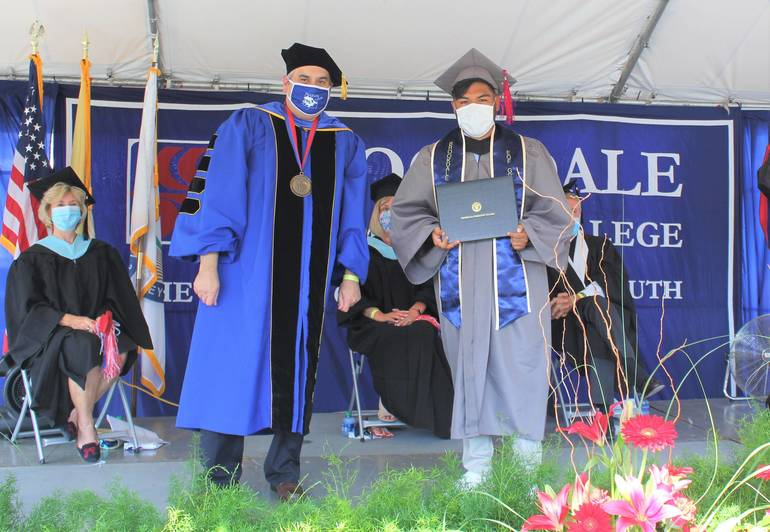 President Dr David Stout with a graduate.jpg
