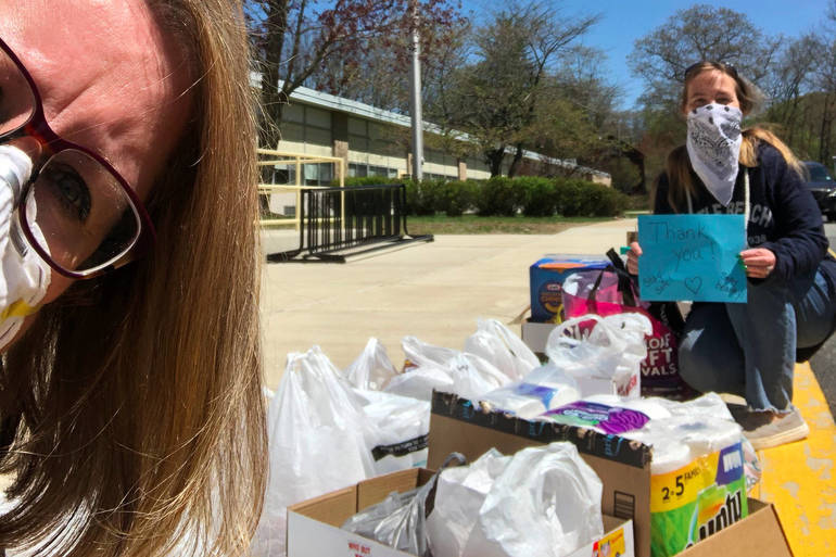 Principal Lynch and Kerry Hamberger at Food Drive Collection.png
