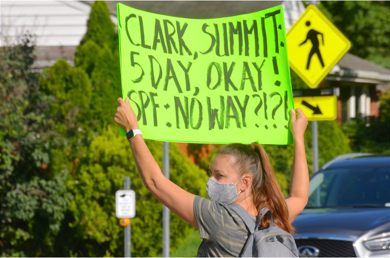 Protester with sign.png