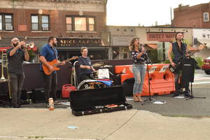 Musicians play on Quimby Street in Westfield Friday, July 23, 2021.