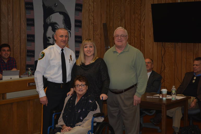 Lieutenant Thomas Fisher, with his wife Michelle and parents Randy and Julie Fisher