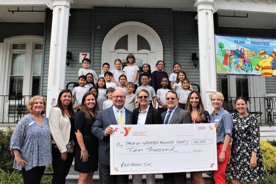 Top story d60d96d4be1e04c8504a rb charter school check presentation9 26 19