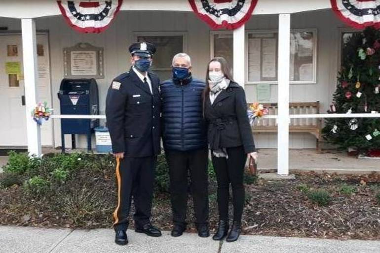 Fanwood police officer Carlos Gonzalez, Jr., and his parents.