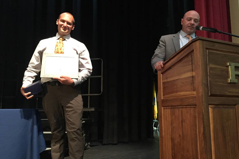 RHS Kulick presented EOY while Miller talks.jpg