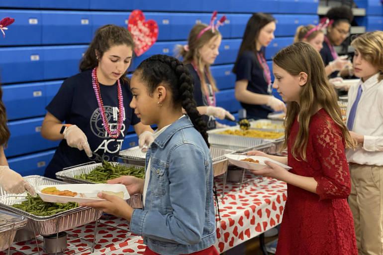 RHS Interact Members and LRS Students serving food.JPG