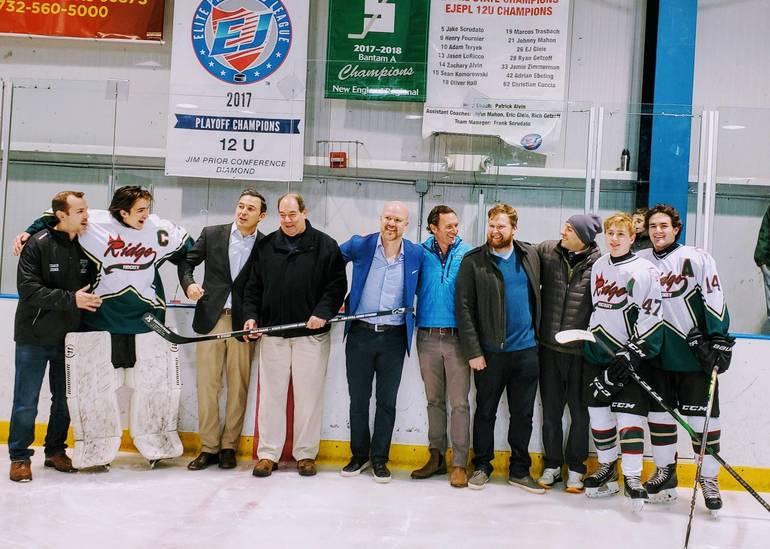 ridge hockey honors coach mullin.jpg