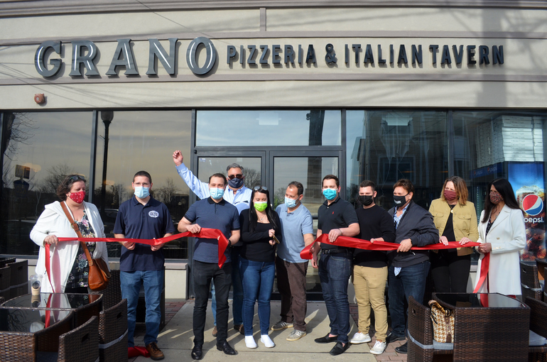 Ribbon-cutting at the grand opening of Grano.png