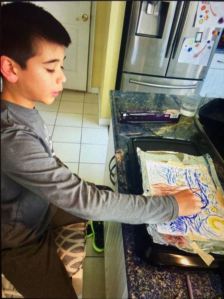 Montessori student Ricky paints his own version of Van Gogh's Starry Night