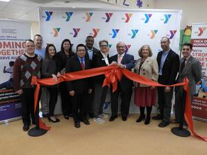 Carousel image b59fe02bd42fe3395c79 ribbon tying celebrating the merger of the community ymca and ymca of western monmouth county