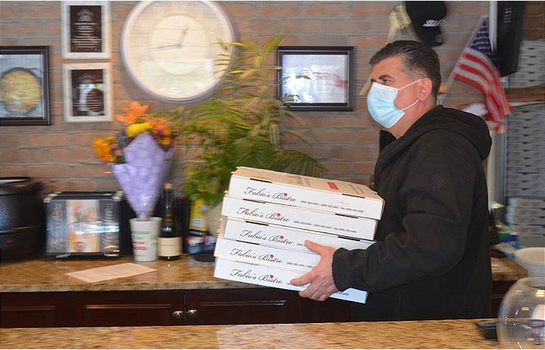 Ronnie Vojka of Fabio's Bistro in Fanwood carries boxes.png