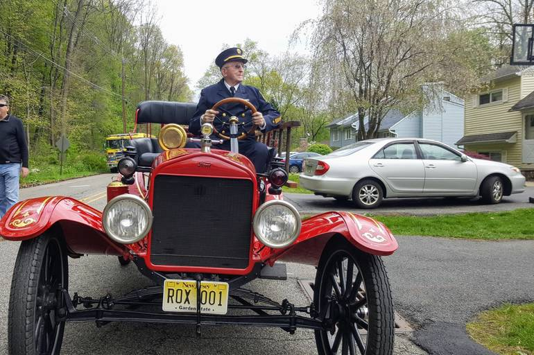 Roxbury Firefighter Lou Bizzari at the wheel.jpg