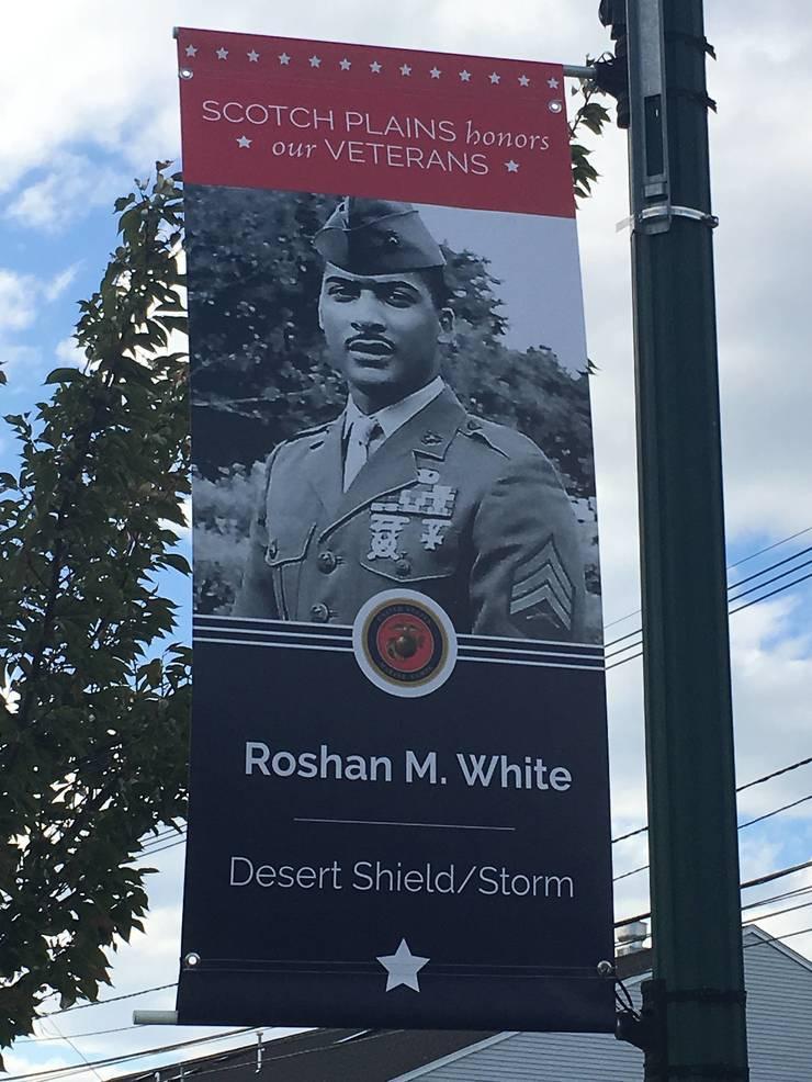 Roshan Roc White banner in Scotch Plains