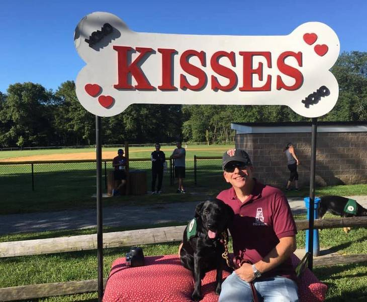 Rob Lax with Tippie (The Dog) at the Kissing Booth.jpg