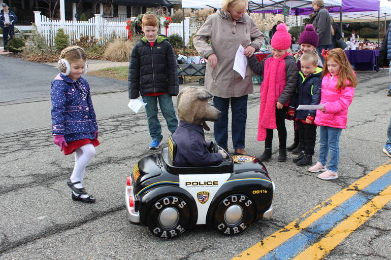 Sarge the police dog talks with kids at last year's Home for the Holidays
