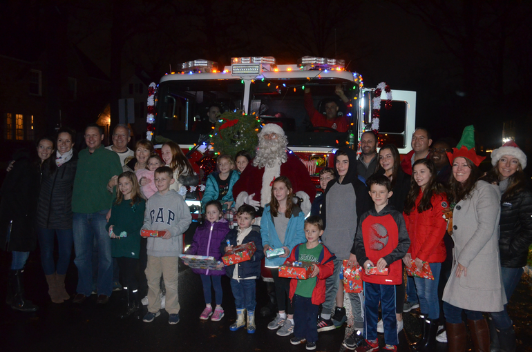 Santa Claus visits Helen  St. in Fanwood.