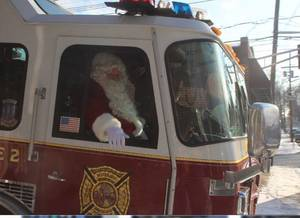 Carousel image 4d00d97147a6f399d7af santa fire truck 2017 a