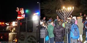 Carousel image fb3ac327e785f5c52293 santa on the firetruck fire truck and menorah lighting  2020 tapinto montville