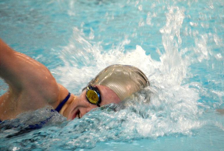 Scotch Plains-Fanwood swimmer Aislinn Mooney wins the 100 Free.
