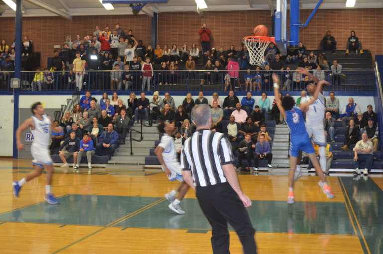 Scotch Plains-Fanwood's Justin Guy scores two of his 10 points against Westfield.png