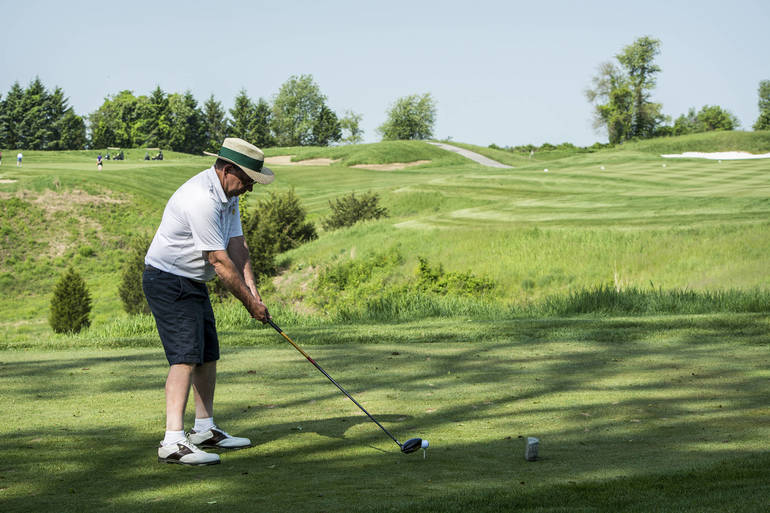A golfer gets ready to tee off.