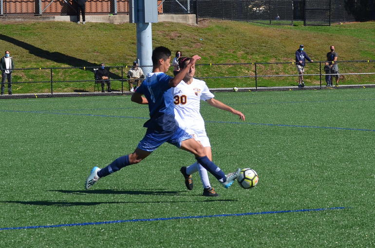 Scotch Plains-Fanwood's Dylan Fei, 19, battles Summit's Henry Olson (30) for the ball.png