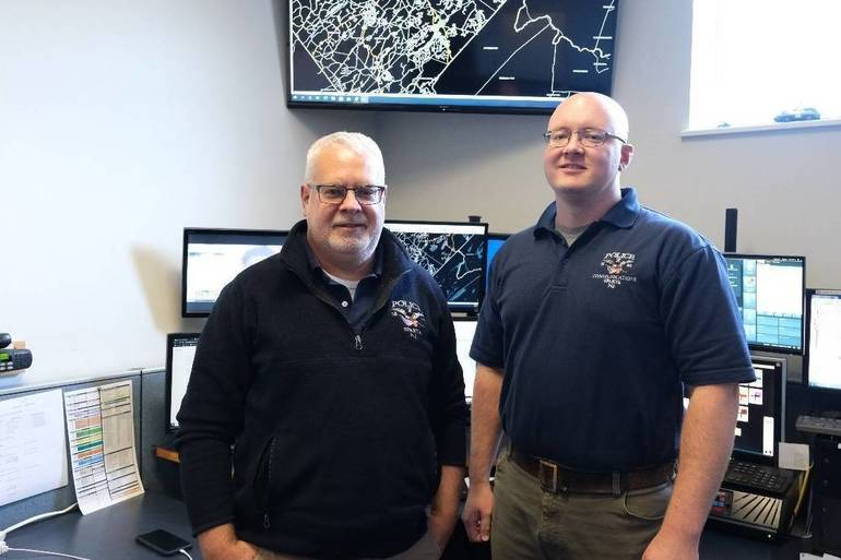 Scot Sorensen, SPD lead dispatcher, left, with partner Tom McIntyre.  October 4, 2020.  Daniel Devine..jpg