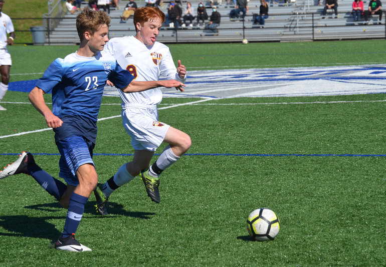 Scotch Plains-Fanwood's Calum Murray (23) and Summit's Sean Hendrie (9).png