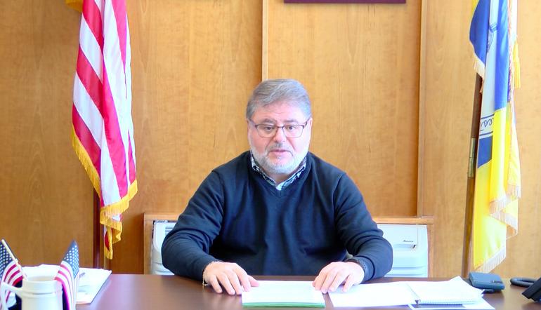 Wayne Mayor Chris Vergano at his desk.png