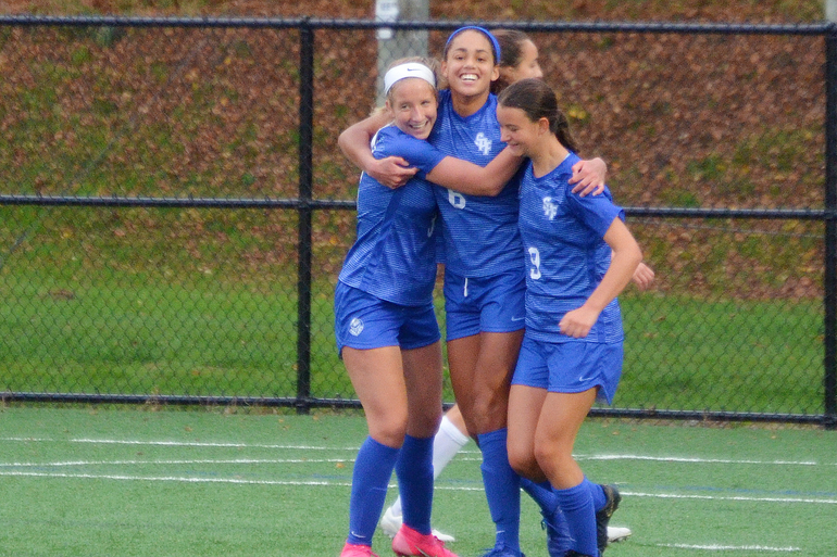 Scotch Plains-Fanwood's Corinne Lyght is congratulated by teammates after scoring the Raiders' second goal of the day.png