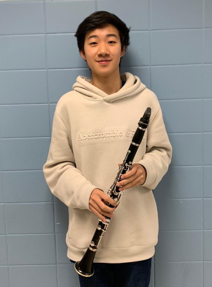 Scotch Plains-Fanwood HS senior Jonathan Yu with his clarinet.png